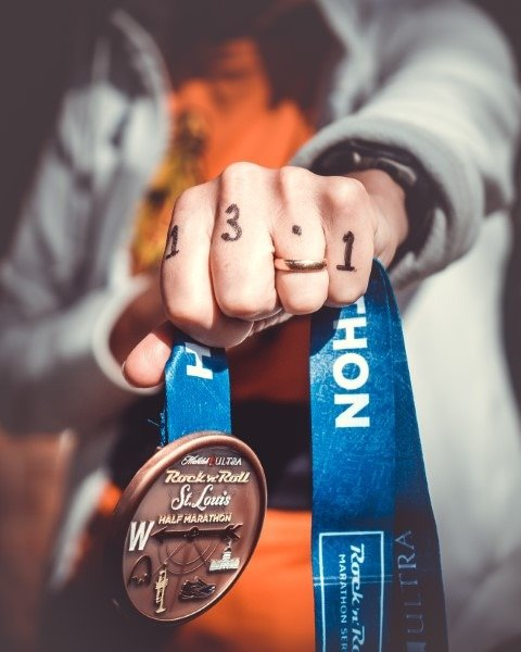 Tight fist holds a medal